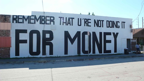 "Graffiti wall saying ""Remember that U&squot;re Not Doing It For Money"""