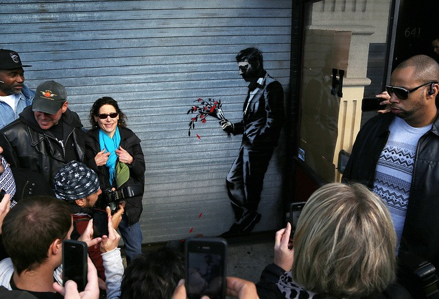 Banksy and the crowds. Photo by carnagenyc.