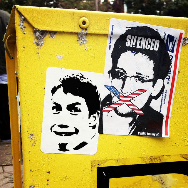 An anonymous artist's portrait of Edward Snowden, next to a Borf sticker. Photo by RJ Rushmore.