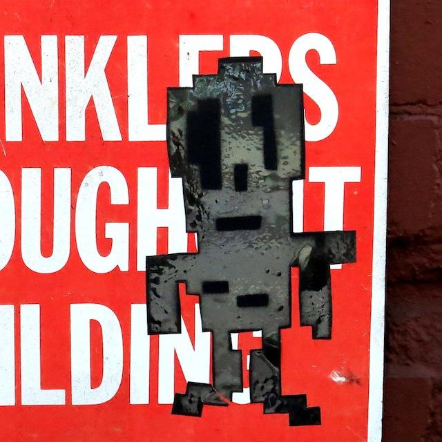Stikman-street-art-sticker-in-Chelsea