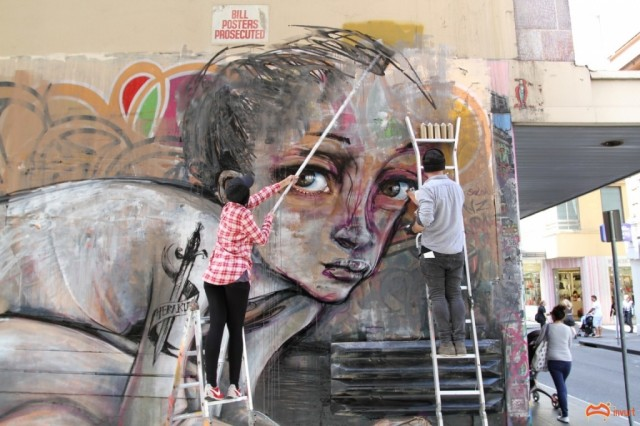 Herakut painting in Union lane Melbourne - Photo by David Russell