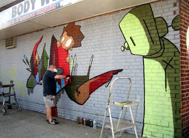 Veng at work on collaborative mural with Chris, RWK. Photo by Tara Murray