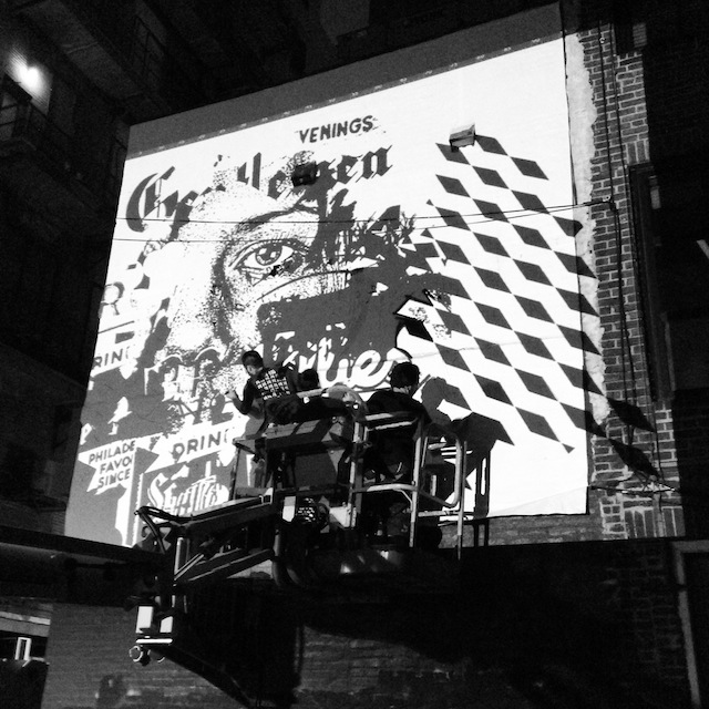 Vhils and his crew projecting on the wall. Photo by Lisa Murch.