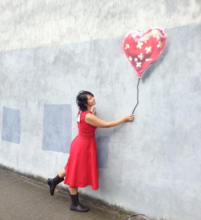 Saki Waki with Banksy's latest piece. Photo courtesy of The L.I.S.A. Project.