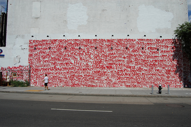 Partial buffed Barry McGee mural at Bowery and Houston (the buff marks cover more red tags). Photo by Andrew Russeth.