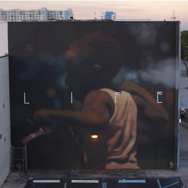 """Life"" by Axel Void on JJD. The artist comments, ""The school is located in the neighborhood of Wynwood, a gentrified area where street art and the fashion industry have built a frivolous trend with the reputation of having the best murals in the world, but has rather become a circus in the pursuit of fame. "" Photo by Axel Void."