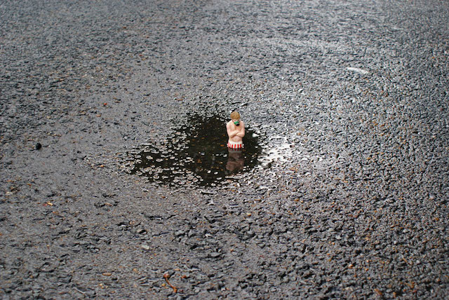Isaac Cordal sculpture at a playground in London in 2010. Photo courtesy of Isaac Cordal.