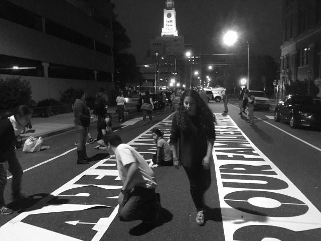 Michelle Angela Ortiz installing a piece for the Cit of Philadelphia Mural Arts Program.