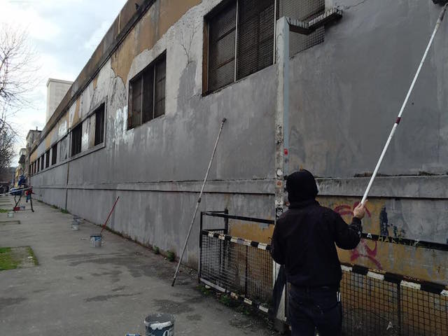 Blu's work being buffed in Bologna, Italy